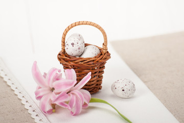 Little Braided Wooden Basket With Chocolate Eggs On Handmade Nat