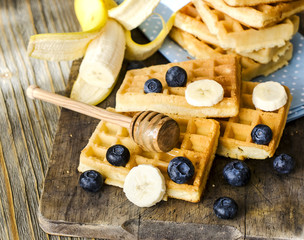 Fresh waffles with  blueberries and banana for breakfast