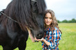 Young beautiful girl with frisian horse - 79296687