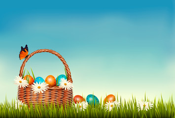 Spring Easter background. Basket with Easter eggs in grass with