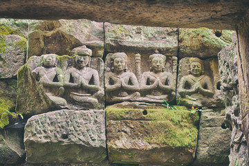 carved statues, Angkor, Cambodia