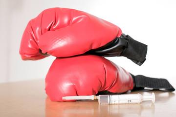 Boxhandschuhe mit Spritze