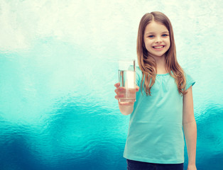 smiling little girl giving glass of water
