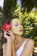 Woman with Indian Multani Matti clay facial mask, beauty spa