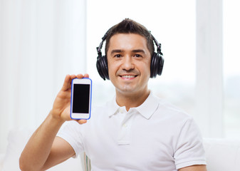 happy man with smartphone and headphones