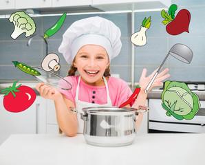 cute little girl preparing vegetarian soup