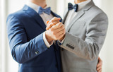 Fototapety close up of happy male gay couple dancing