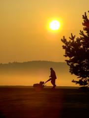 Morning golf worker