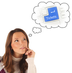 Close-up portrait of girl dreaming about on-line tickets order s