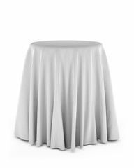 Round pedestal with white cloth over white background