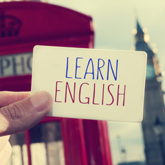 text learn english in a signboard with the Big Ben in the backgr
