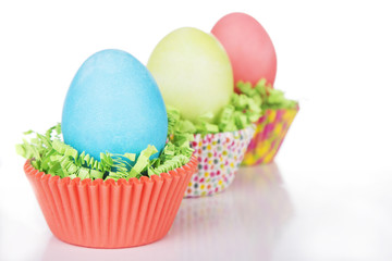 Dyed Easter eggs in a nest of green grass