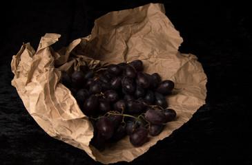 Purple Grapes on paper dark still life