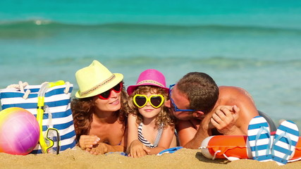 Happy family having fun at the beach. Summer vacations concept