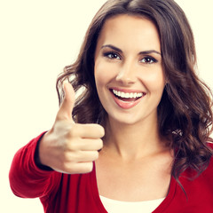 Young woman showing thumbs up gesture