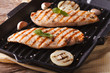 Chicken fillet with onion and basil in a pan grill horizontal