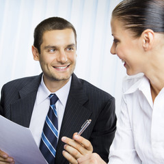 Businessteam or client and businessman, at office