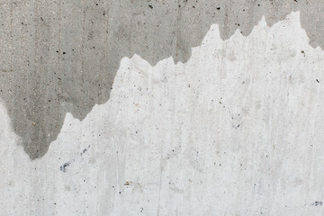 Background texture of a half painted plaster wall