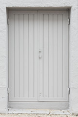 Double white painted wood exterior doors
