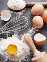 Dough preparation. Baking ingredients: egg and flour.