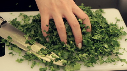 girl shakes parsley for salad