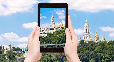 tourist taking photo of Kiev Pechersk Lavra
