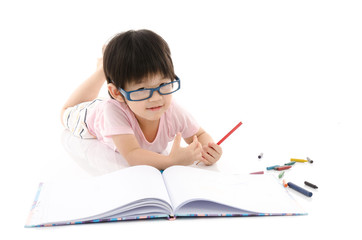 Little asian boy wearing eye glasses and writing