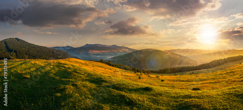 Deurstickers Weide, Moeras agricultural field in mountains at sunset