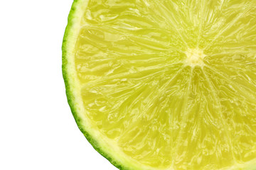 slice of lime fruit on a white background