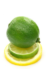 one whole lime fruit on top of a slice lime and lemon