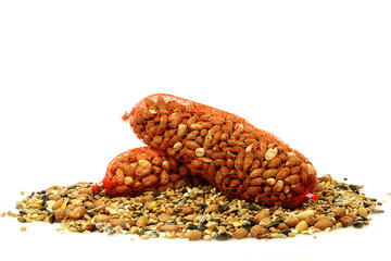 mixed bird feed and peanuts in plastic nets