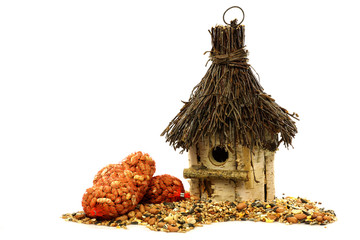 Birdhouse with bird feed on a white background