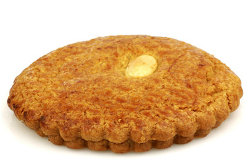 "Dutch traditional pastry called""gevulde koek"" on a white backgro"