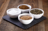 Aromatic spices in white bowls poster