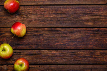 Fresh apples on wooden table with copy space