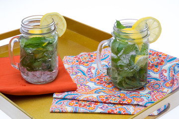 Cold Water with Lemon and Mint in Glass Jars