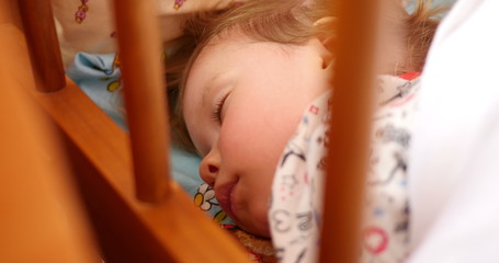 Sleeping little baby girl face