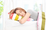Fototapety Beautiful woman sleeping in a bed at home