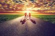 Family walk on long straight road, way towards sunset sun - 79319807