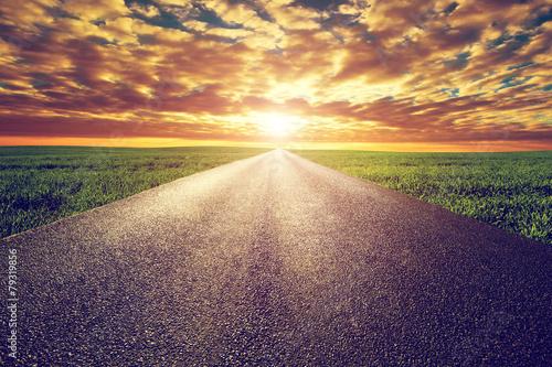 Long straight road, way towards sunset sun - 79319856