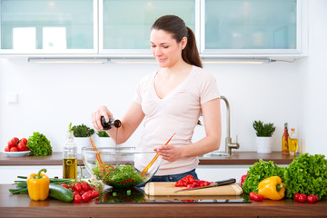 Young woman in the kitchen prepare salad VIII