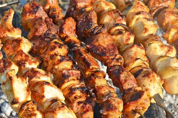 Shish kebab on skewers and hot coals