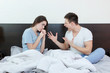 annoyed young caucasian couple after quarreling in bedroom unde