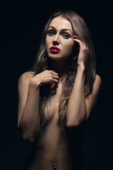 topless woman in dark