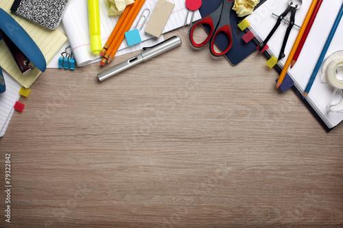 Leinwanddruck Bild Desk cluttered with office supplies