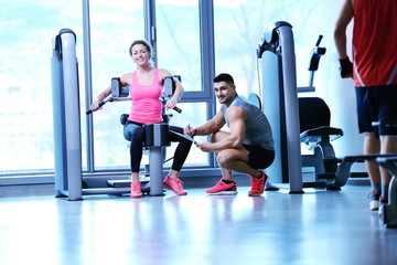 woman exercising with her personal trainer