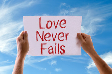 Love Never Fails card with sky background