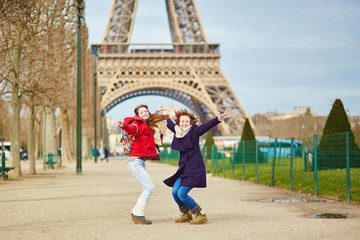 Two girls in Paris near the Eiffel tower