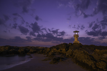 Lighthouse on rock after sunset at Thailand.