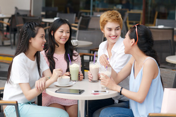 Female friends in the cafe